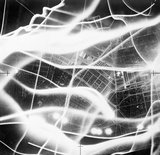 A vertical aerial photograph taken during a raid on Berlin on the night of 2/3 September 1941. The broad wavy lines are the tracks of German searchlights and anti-aircraft fire.