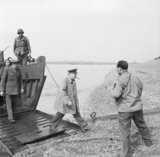 Winston Churchill steps ashore from an American assault landing craft onto the east bank of the River Rhine, near Wesel, 25 March 1945.