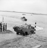 DUKW amphibious vehicles ferrying supplies across the Rhine, 25 March 1945.