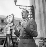 General Charles de Gaulle addressing crowds in Chartres, France, 24 August 1944.