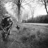 Infantry of 2nd Battalion, The Wiltshire Regiment, supported by Churchill tanks of 6th Guards Tank Brigade, clear a pocket of resistance south of Lubeck in Germany, 2 May 1945.