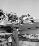 WAAF armourers and flight mechanics servicing a Hawker Hurricane at Sealand in Wales, 5 May 1943.