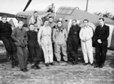 Squadron Leader Douglas Bader with pilots of No. 242 Squadron in front of his Hawker Hurricane at Duxford, September 1940.