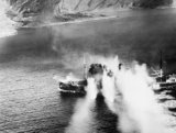 Rocket projectiles strike the 1,367-ton Norwegian merchant vessel LYNX during an attack by Bristol Beaufighters and de Havilland Mosquitos of the Banff Strike Wing in Stav Fjord, 19 September 1944.