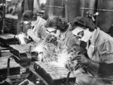 Women welders making stirrup pump handles during the Second World War.