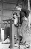 Iris Joyce, a new recruit to the Women's Land Army is weighed at the Northampton Institute of Agriculture, during 1942.