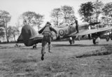 A pilot of No. 175 Squadron RAF scrambles to his waiting Hawker Typhoon Mk IB fighter-bomber at Le Fresne-Camilly in Normandy, 24 July 1944.