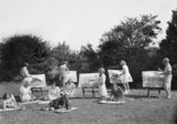 Evacuees from Blackheath and Kidbrooke School in Greenwich, London attend an open-air art class in the grounds of their new school at Penygroes, Carmarthenshire, Wales in 1940.