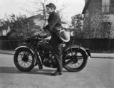 Mr W A J Dearn, a motorcycle messenger attached to Wood Green Post Office, 1941.