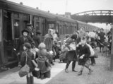 A group of children arrive at Brent station near Kingsbridge, Devon, after being evacuated from Bristol in 1940.