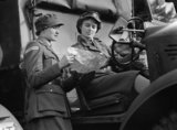 A trainee driver from the Auxiliary Territorial Service (ATS) receives instructions at ATS motor transport training centre at Camberley in 1941.