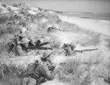 Men of 7th Battalion, The Green Howards on an exercise among the sand dunes at Sandbanks, near Poole in Dorset, 31 July 1940.