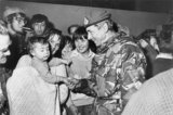 Major General Jeremy Moore, Royal Marines, Commander of the British Forces in the Falklands, meets jubilant Falkland Islanders in Port Stanley after the signing of the Argentine surrender, 15 June 1982.