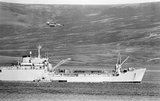 An Argentine Dagger aircraft makes a low-level attack on RFA SIR BEDIVERE in San Carlos Water in the Falkland Islands, 24 May 1982.