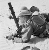 Rhodesian troops of the 60th King's Royal Rifles training with a 2-inch mortar in North Africa, 12 May 1942.