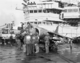 A Harrier GR.3 of No. 1 Squadron RAF is prepared for a sortie on board HMS HERMES during the Falklands War, 1982.
