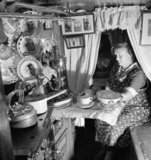Mrs Skinner prepares the evening meal in the cabin of her husband's canal boat during 1944.