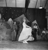 "Leading Aircraftwoman Esther Bashford of the Women's Royal Air Force dances to the tune of ""When the Blue of the Night meets the Gold of the Day"" during a midnight cabaret put on at RAF Uxbridge during 1944."