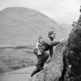 A soldier from No. 1 Commando climbs up a steep rock face during training at Glencoe in Scotland, 19 November 1941.
