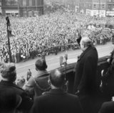 Winston Churchill gives his famous 'V for Victory' sign while addressing crowds from the balcony of City Hall in Sheffield, during a tour of the Midlands and North of England, November 1941.