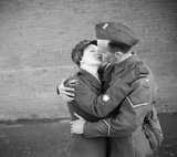 Staff Sergeant-Major Twist of the ATS embraces and kisses her husband, Lance-Bombardier Twist during a special photo-shoot at Army Headquarters in Northern Ireland, 22 October 1941.