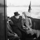 Winston Churchill and his wife, Clementine, on board a naval auxiliary patrol vessel during a visit to the London docks, 25 September 1940.