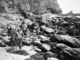 Mule handlers of the Royal Indian Army Service Corps negotiate rocky terrain while on exercise in the UK, 16 November 1940.