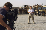 BBC journalist Alastair Leithead records a report about the ceremony marking the American handover of control of the Helmand Provincial Reconstruction Team to British forces in the PRT Compound at Lashkar Gah, Helmand, Afghanistan, 1 May 2006.