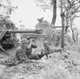 A British 17-pdr anti-tank gun and Sherman tank near Cassino, Italy, 17 May 1944.