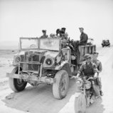 A CMP truck and motorcycle of 11th Royal Horse Artillery (Honourable Artillery Company), 1st Armoured Division, Tunisia, 22 April 1943.