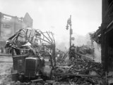 A wrecked bus stands among a scene of devastation in the centre of Coventry after the major Luftwaffe air raid on the night of 14/15 November 1940.