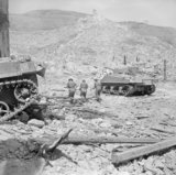 Sherman tanks and infantry in the ruins of Cassino, Italy, 18 May 1944.