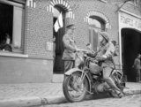 A motorcycle despatch rider delivers a message to the signals office of 1st Border Regiment at Orchies, France, 13 October 1939.