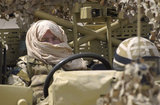 The crew of a Land Rover WMIK in Kuwait during preparations for Operation 'TELIC', the invasion of Iraq, 2003.
