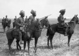 Forward scouts of the 9th Hodson's Horse, an Indian cavalry regiment, pause to consult a map, near Vraignes, April 1917.