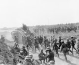 Battle traffic at Grevillers 25 August 1918. Mark V Tanks and infantry going forward following the Capture of Grevillers by  the New Zealand Division.