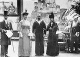 Petty Officer Ernest Herbert Pitcher VC with his wife and King George V and Queen Mary at the private view of the Exhibition of Naval Photographs, Princes Galleries, Piccadilly, London, 21 July 1918.