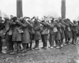 A line of British troops blinded by tear gas at an Advanced Dressing Station near Bethune, 10 April 1918.