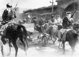 Mounted Sharifan irregulars riding through the dusty streets of Damascus soon after the capture of the city on 1 October 1918.