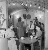 Munitions workers relaxing in the 'lounge' at an underground factory on the Wirral in 1945.