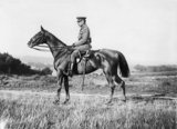 A formal portrait of Field Marshal Sir Douglas Haig on horseback at Poperinghe. Haig was Commander-in-Chief of the Western Front, 1915 - 1918.