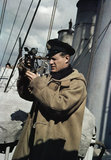 A Royal Navy officer using a sextant aboard a destroyer on convoy protection duties, 1942.