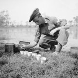 An RAMC orderly testing to see if the right quantity of chlorine is present in drinking water in Burma, April 1945.