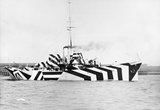 The Gunboat HMS KILDANGAN in dazzle camouflage, 1918.