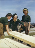 Land Army girls being taught to saw wood at the Women's Timber Corps training camp at Culford in Suffolk.
