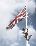 Nathaniel Pemberton, a pupil at Molineux School on St Kitts in the Leeward Islands, climbing a flagpole to tie the Union Flag, March 1955.