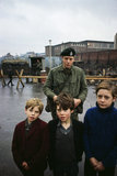2nd Lieutenant Nicholas Dixon of 1st Battalion The Royal Green Jackets, with a group of children in Belfast, 1969.