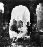 The western bell towers of St Paul's Cathedral in London seen through an archway after the heavy incendiary raid of 29 December 1940.