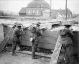 British Lewis gunners manning a barricade at a bridge crossing the Lys Canal at Marquois, 13 April 1918.