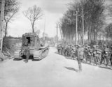 Infantry of the New Zealand Division and Whippet tanks advancing through Maillet Mailly 26 March 1918.